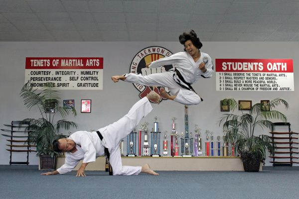 Duc dang taekwondo instructor tam bui and instructor kim anh side kick