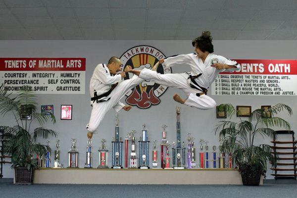 Duc dang taekwondo hoi nguyen and instructor kim anh flying side kick